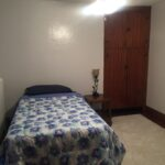 Upstairs bedroom with twin bed.